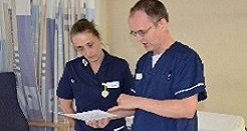 Doctor and Nurse studying patient chart