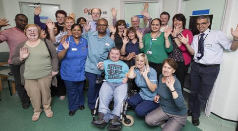 Rheumatology staff and patients waving for World Arthritis Day