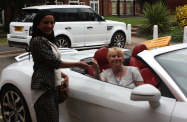 Nurse Debbie winning luxury Audi Spyder R8 for the day