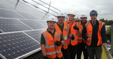 Green-Electrician-contractors-and-SWBH-Estates-Officer-Nicholas-Lane-far-right-pose-alongside-the-newly-installed-PV-Panels.-231x121