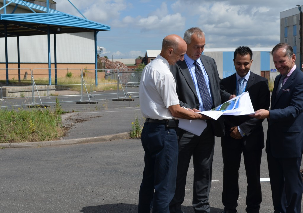 Caption: (L-R) Graham Seager, Director of Facilities/New Hospital project explains the plans for the new hospital to Richard Douglas, Director General, Strategy and Finance, NHS England, Waheed Saleem, Chair at Right Care Right Here NHS Partnership and Richard Samuda, Trust Chair.