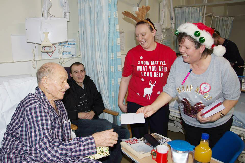 Sandwell Hospital patient Bill receives his gift from Tesco Extra staff.
