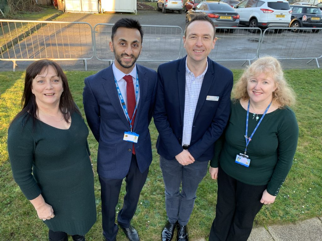 Left to right) Dottie Tipton, with GP Imran Zaman and GP Dr James Gwilt with Mel Roberts Deputy Chief Operating Officer.