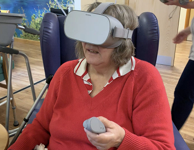 Daphne Barnes a patient has a go at VR at the Sandwell Day Hospice