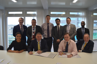 Representatives from the Trust and Engie sign a contract to signify a long term facilities management deal with the provider.