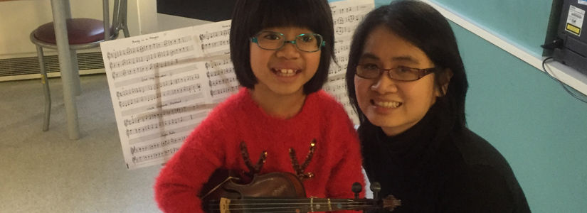 A young patient raises money for Your Trust Charity by playing the violin. Here she is pictured with her mum.