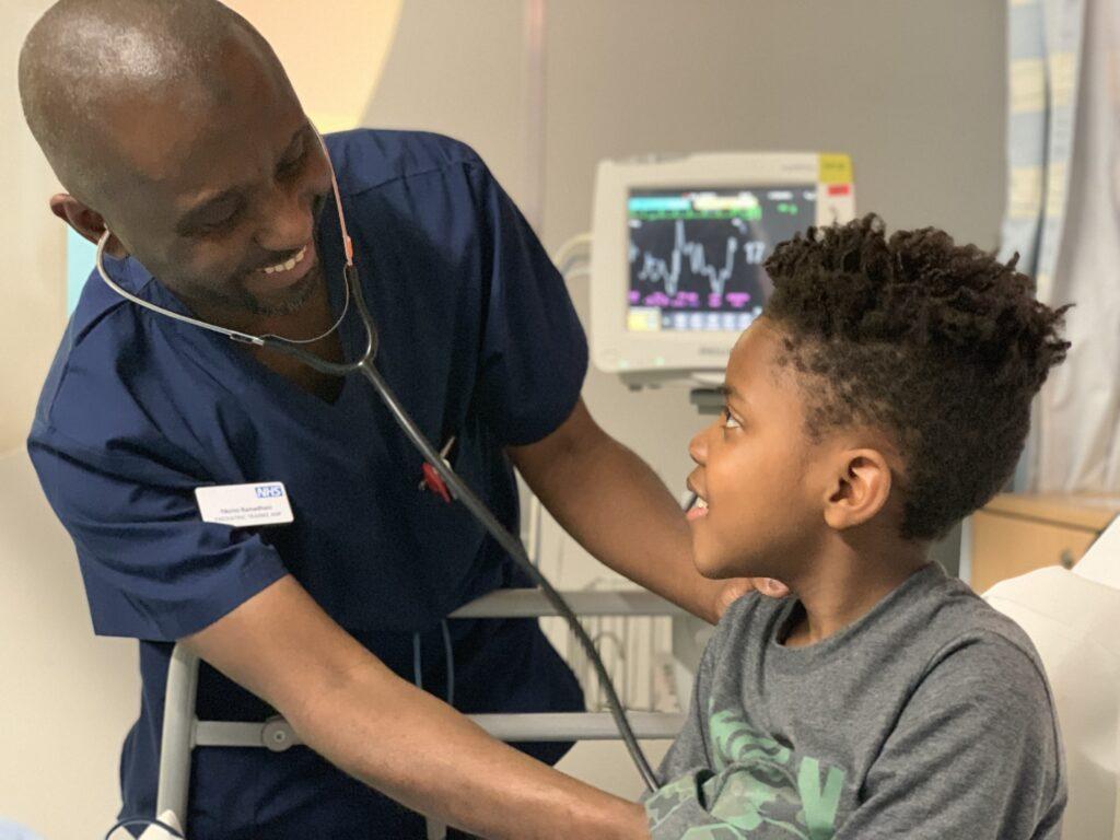 Staff member Fikirini treats Lance